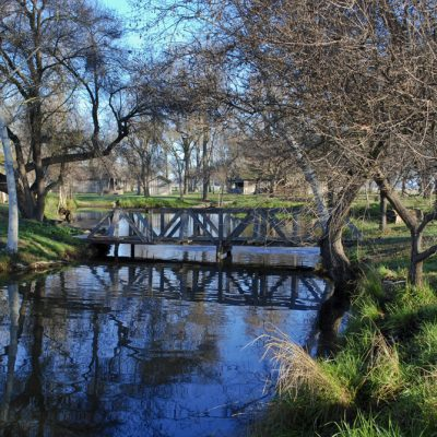 Wooden foot bridge over the pond at Jack Stone Barn between Lemoore and Hanford, California.