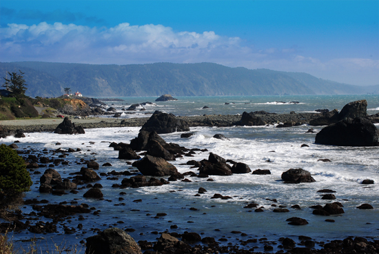 Pacific ocean waves crash over rocks at Crescent City, California