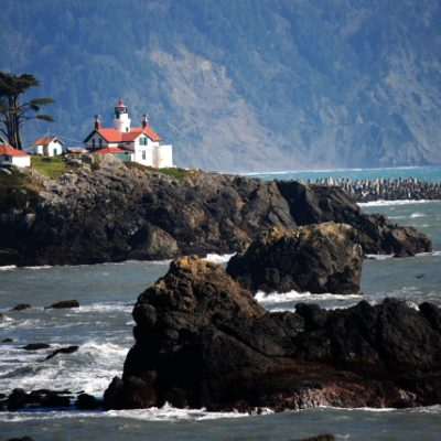 Battery Point Lighthouse in Crescent City, California overlooks the crashing waves of the Pacific Ocean.  This is a 150-plus year old lighthouse that is still active.